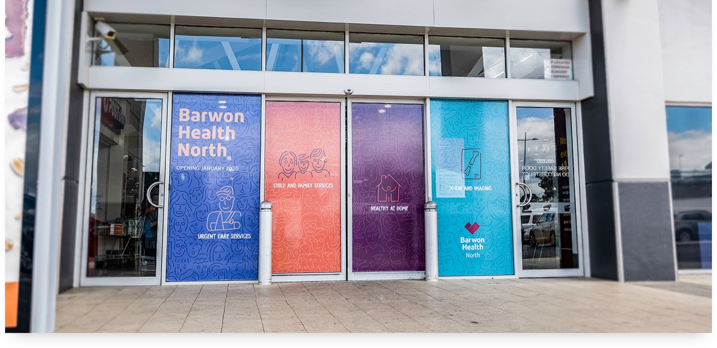 Signage on front doors of the Corio Village shopping centre